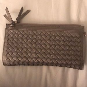 Woven leather brown clutch