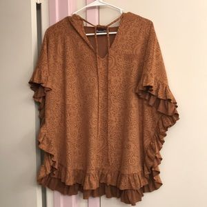 Hooded brown patterned poncho with ruffle trim