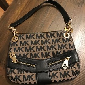 Michael Kors Small black purse with gold detail