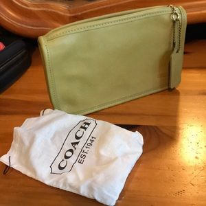 Green coach purse.