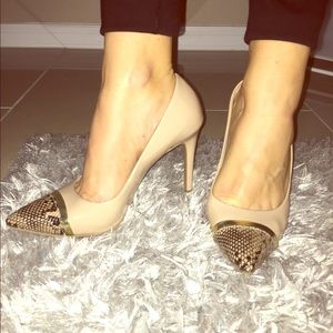 Nude patent and snakeskin pumps
