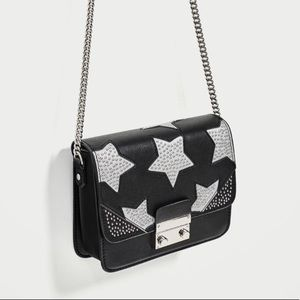 Crossbody bag with reflective stars
