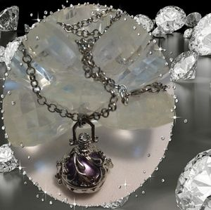 Mexican bola silver angel callers necklace, purple