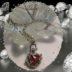 Mexican bola silver angel callers necklace, red