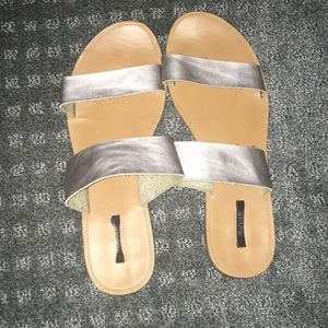 Gently used silver leather straps slides