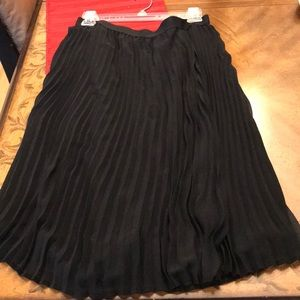 Black pleated skirt midi length