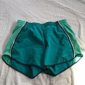 Teal Nike running shorts