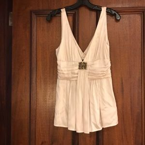 Sleeveless white silk blouse