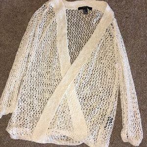 Holed cardigan sweater