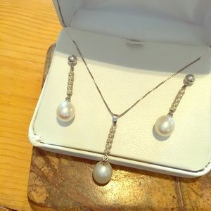 Three piece necklace and earrings set