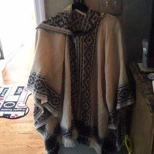 Poncho with flairs and hood