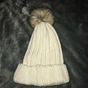 Cream beanie with fluff ball
