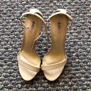Nude open-toed high heels