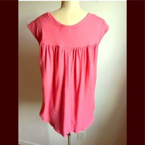 Pink top with high to low hem length