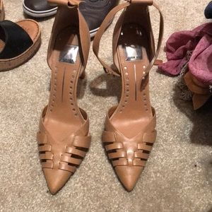 Soft brown leather heels missing one strap