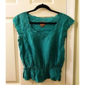 Turquoise top with flower details