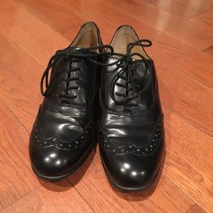 Black leather oxfords by Nine West