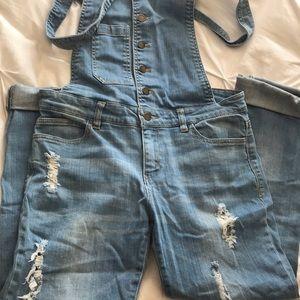 Distressed denim overall skinny jeans