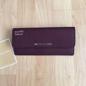 d95aa8edb45f Michael Kors Bags - Michael Kors Slim Plum Color Envelope Wallet NWT