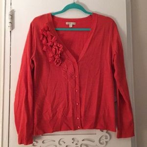 Peachy coral cardigan with rosette detail