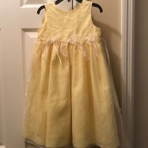 Yellow dress with white floral embroidery