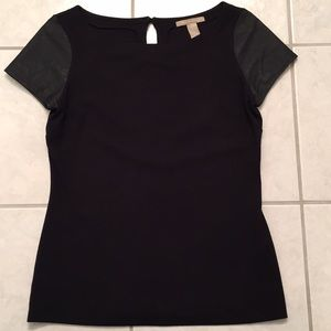 Leather sleeved black top