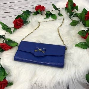 Blue clutch with bow
