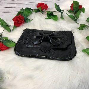 Black Aldo bow clutch