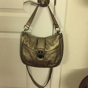 MK gold color purse