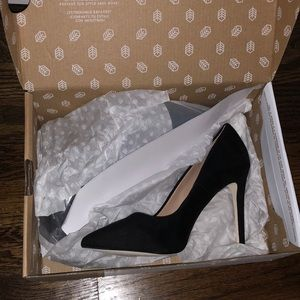 Never worn black heels brand Call It Spring.
