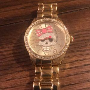 Betsy Johnson gold skull watch