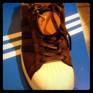 Dark brown/black Adidas