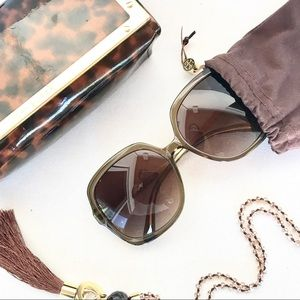 Tory Burch large frame sunglasses.