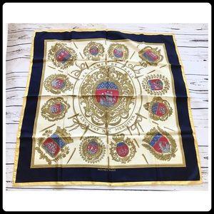 An Hermès Les Armes de Paris silk scarf.