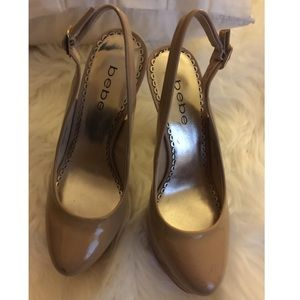 Bebe nude patent leather cork heels