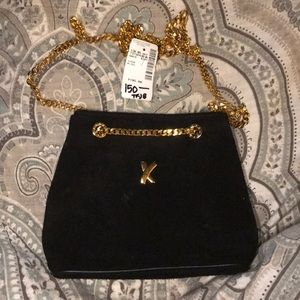 Paloma Picasso suede gold chain shoulder purse.