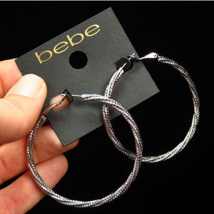 bebe silver hoop earrings  NWT BBE40