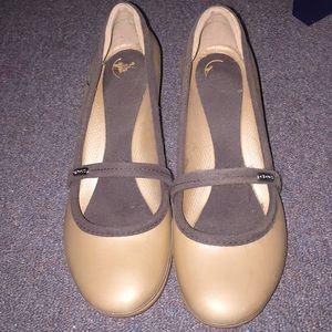 Crocs gold w/ brown trim wedge heels.