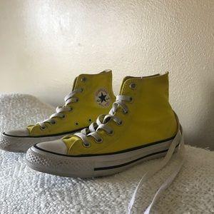 Yellow high top converse