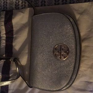 Tory Burch gold metallic cross body handbag.