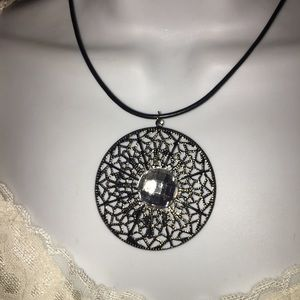 Very light weight pendant on leather cord NWT