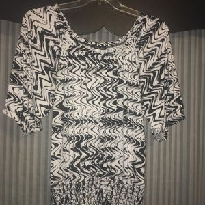 Black and white blouse. Fitted waist