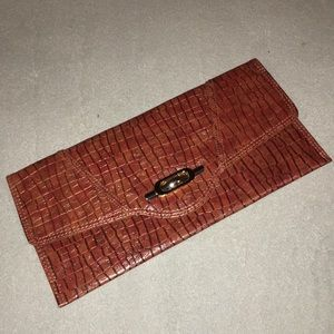 Brown clutch with a silver & gold accent