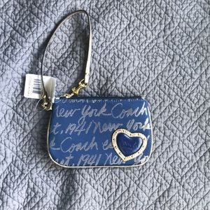 Coach wristlet in denim and gold