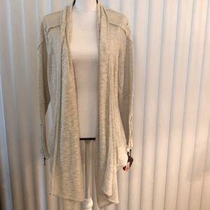 Cream jacket with zipper sleeves