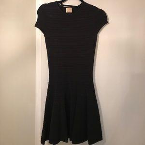 Torn black textured knit flare dress