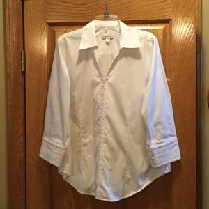 White clean fit shirt with hidden front zipper.