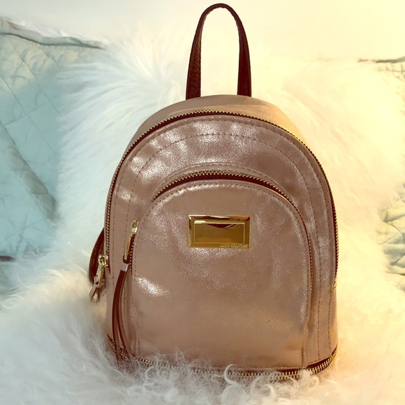813ed8df34 Juicy Couture Handbags - Juicy Couture Rose Gold Mini Backpack