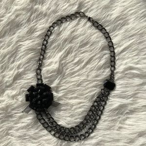 Black necklace with flower detail