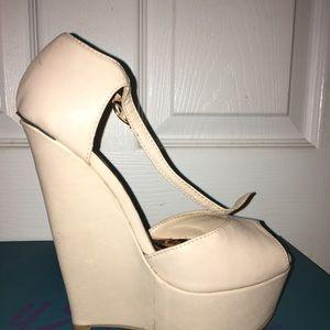 Beige open toed wedge sandals